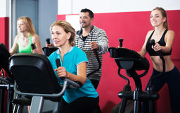 Active adults in gym Stock Photos