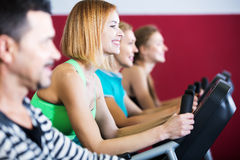 Active adults in gym Stock Images