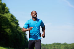 Active african american man running. Portrait of an active african american man running exercise workout outdoors stock photography