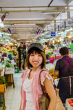 Active Asian tourism is touring in Thailand open market. Active Asian girl tourism is touring in Thailand open market royalty free stock photos