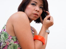 Active Asian woman uses mobile phone Stock Images
