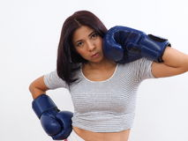 Active Asian woman wearing blue boxing gloves Royalty Free Stock Photos