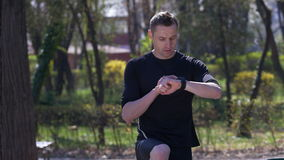 Active athlete looking at a heart rate monitor activity tracker smartwatch stock footage