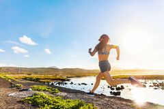 Active athlete running on summer trail nature. Athlete runner trail running on summer trail beach. Active morning jogging motivation woman sprinting with energy stock photos
