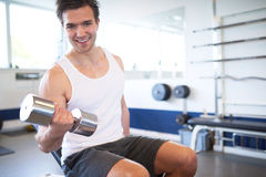 Active Athletic Guy Lifting Weights in the Gym Royalty Free Stock Photography