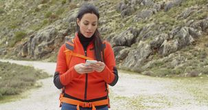 Active attractive woman checking a map stock video footage