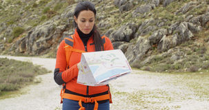 Active attractive woman checking a map Royalty Free Stock Photos
