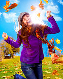 Active autumn 01. Young happy woman with foliage in autumn Stock Image