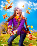 Active autumn 02. Young happy woman with foliage in autumn Royalty Free Stock Images