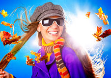 Active autumn 03. Young happy woman with foliage in autumn stock photo