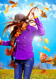 Active autumn 04. Young happy woman with foliage in autumn Stock Image
