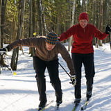 Active Baby Boomers. A Baby Boomer couple playing around on cross country skis in an Ontario park Stock Photo