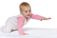 Active baby girl on the white towel Stock Photography