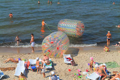 Active beach vacation on the Baltic Sea, inflatable water rollers Stock Images