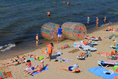 Active beach vacation on the Baltic Sea, inflatable water rollers Royalty Free Stock Photos