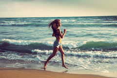 Active on beach Royalty Free Stock Image