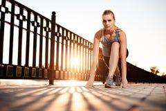 Athletic girl preparing to run Stock Photo