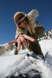 Active beautiful girl with a snowboard. A beautiful active girl with a snowboard Stock Image