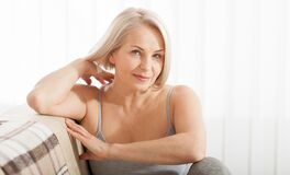 Free Active Beautiful Middle-aged Woman Smiling Friendly And Looking In Camera In Living Room. Woman`s Face Close Up Royalty Free Stock Photo - 180258635