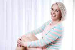 Free Active Beautiful Middle-aged Woman Smiling Friendly And Looking Into The Camera At Home In The Living Room. Stock Images - 70014164
