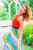 Active beautiful woman in a bright dress Stock Images