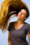 Active beautiful woman with long moving hair stock image
