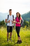 Active Beautiful young couple hiking ina nature climbing hill or Stock Image