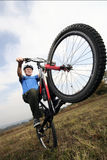Active biking senior. Senior man riding extreme his mountain bike Stock Photo
