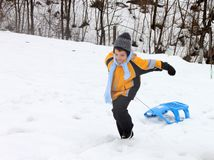 Active boy enjoying a sleigh ride outdoor stock images