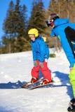 Active boy enjoys ski holidays Stock Images