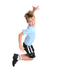 Active boy leaping. Active, energetic and happy go lucky boy leaping and smiling.  fitness or concept Royalty Free Stock Photo