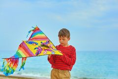 Active boy playing outdoors with a kite. The boy with the kite .The concept of children`s outdoor activities stock photo