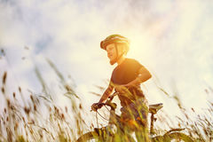 Active boy rides a bicycle Stock Photos