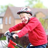 Active boy riding bike on the street Stock Image