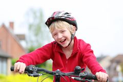 Active boy riding bike on the street Stock Photos