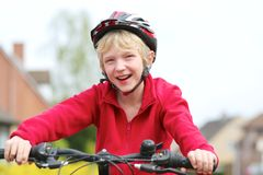 Active boy riding bike on the street Royalty Free Stock Images