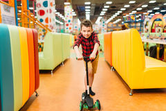 Active boy riding a scooter on playground Royalty Free Stock Photo