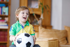 Active boy of 4 watching soccer game Royalty Free Stock Photo