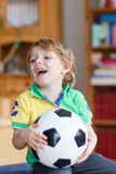 Active boy of 4 watching soccer game Stock Image