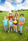 Active boys hold balls Royalty Free Stock Photos