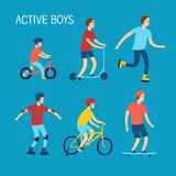 Active boys riding and playing outdoor Stock Photos