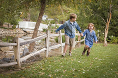 Active Brother and Sister Running Outside Royalty Free Stock Image