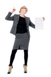 Active business woman with a blank sheet of paper. Girl in full growth with a raised finger Stock Photos