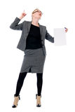 Active business woman with a blank sheet of paper. Girl in full growth with a raised finger Stock Images