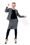 Active business woman with a blank sheet of paper. Girl in full growth with a raised finger Royalty Free Stock Photos