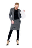 Active business woman with a blank sheet of paper. Isolated on a white background. Full length Stock Photo