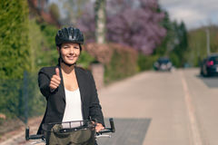 Active Businesswoman on her Bike Showing Thumbs up Stock Photography