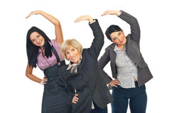 Active businesswomen stretching hands Royalty Free Stock Photos