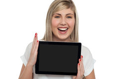 Active caucasian girl displaying tablet device Royalty Free Stock Images