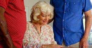 Active Caucasian senior people looking at photo album in nursing home 4k